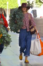ALI LARTER Buys Christmas Wreath at Farmers Market in Los Angeles 11/25/2017