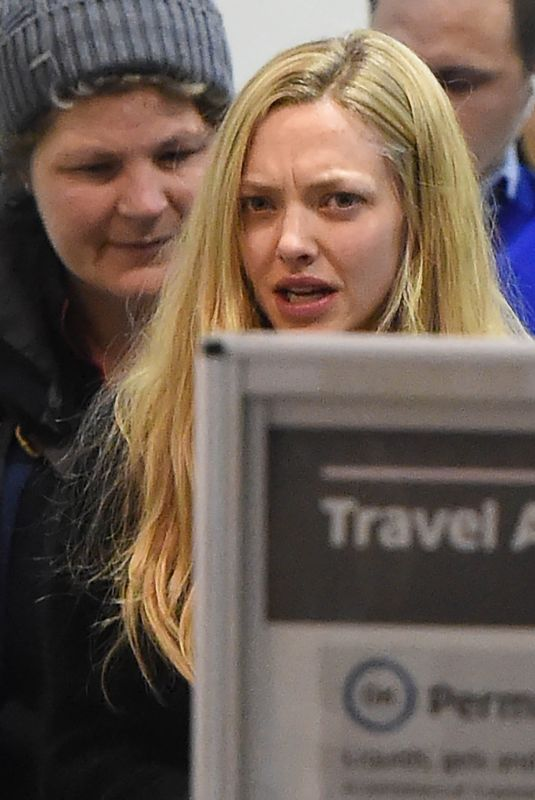 AMANDA SEYFRIED at LAX Airport in Los Angeles 11/27/2017