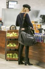 ASHLEY BENSON at LAX Airport in Los Angeles 11/22/2017