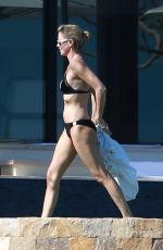 CHARLIZE THERON in Bikini on the Beach in Los Cabos 11/23/2017