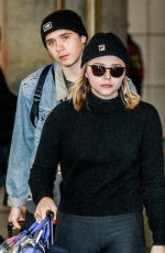 CHLOE MORETZ and Brooklyn Beckham at JFK Airport in New York 11/27/2017