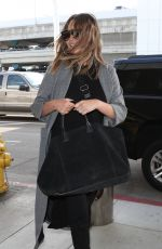 CHRISSY TEIGEN at LAX Airport in Los Angeles 11/15/2017
