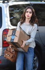 LILY COLLINS Arrives at Fedex in Beverly Hills 11/21/2017