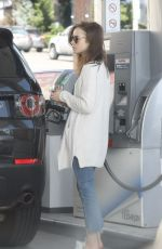 LILY COLLINS at a Gas Station in Los Angeles 11/18/2017