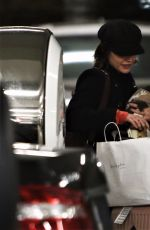 LUCY HALE with Her Dog at Airport in Vancouver 11/27/2017