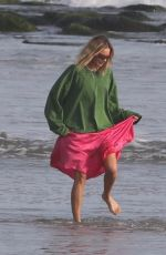 MARGOT ROBBIE on the Set of a Christmas Photoshoot at a Beach in Malibu 11/08/2017