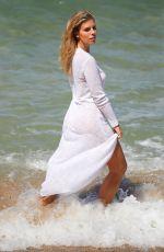 NATASHA OAKLEY on the Set of a Photoshoot at a Beach in Sydney 11/08/2017