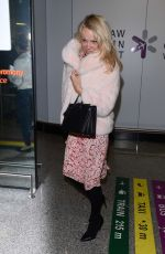PAMELA ANDERSON at Airport in Warsaw 11/24/2017