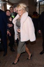 PAMELA ANDERSON Leaves Her Hotel in Warsaw 11/25/2017
