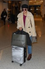 VANESSA HUDGENS at LAX Airport in Los Angeles 11/10/2017