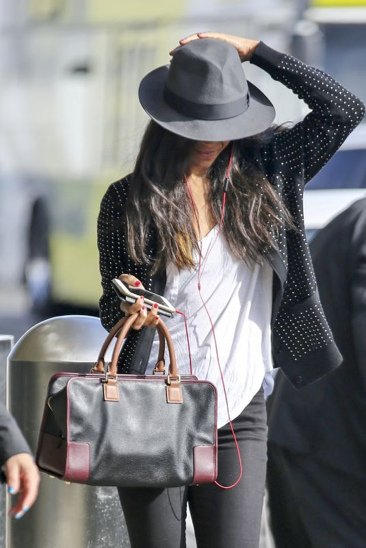 ZOE SALDANA at LAX Airport in Los Angeles 11/21/2017