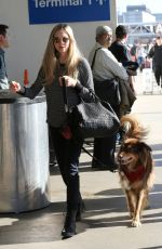 AMANDA SEYFRIED and Her Dog at LAX Airport in Los Angeles 11/27/2017