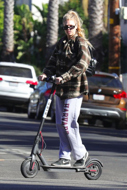 CHARLOTTE MCKINNEY Tides a Bird Scooter in Santa Monica 12/18/2017