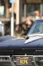 CINDY CRAWFORD and Rande Gerber in Classic Corvette Convertible Driving Out in Malibu 12/23/2017