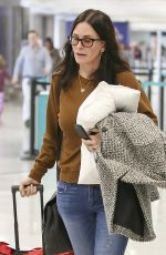 COURTENEY COX at LAX Airport in Los Angeles 12/09/2017