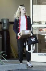 ELLE FANNING Leaves a Ups Store in Studio City 12/29/2017