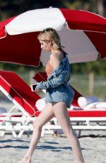 EMMA ROBERETS in Covered Bikini at a Beach in Miami 12/13/2017