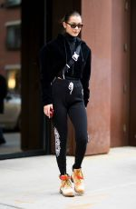 GIGI and BELLA HADID Out in New York 12/20/2017