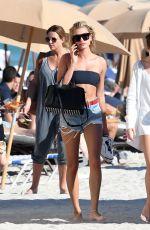 HAILEY BALDWIN in Bikini Top at a Beach in Miami 12/29/2017