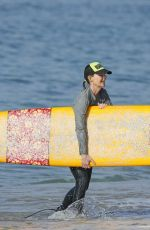 HELEN HUNT in Bikini Top Surfing in Hawaii 12/19/2017