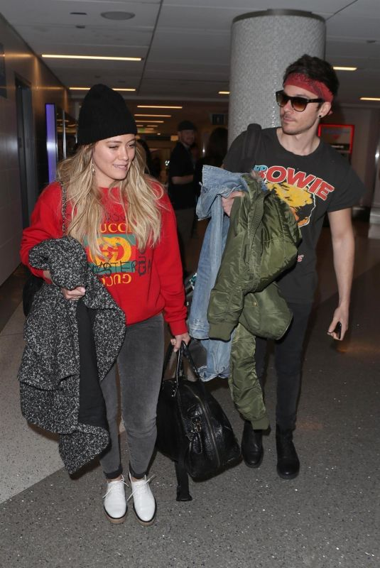 HILARY DUFF and Matthew Coma at LAX Airport in Los Angeles 12/21/2017