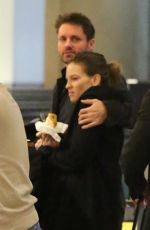 HILARY SWANK and Philip Schneider at LAX Airport in Los Angeles 12/17/2017