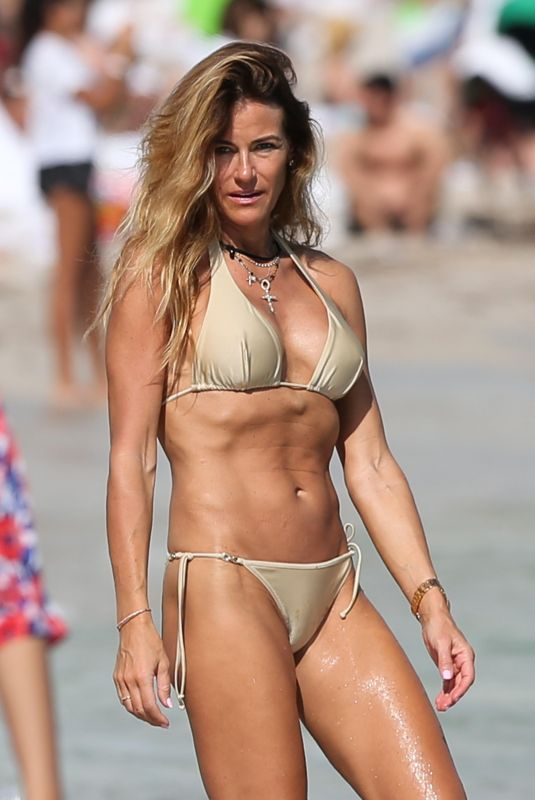 KELLY BENSIMON in Bikinis at a Beach in Miami 12/27/2017