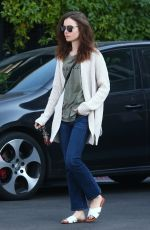 LILY COLLINS Out and About in Hollywood 12/16/2017