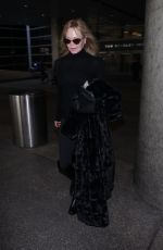 MELANIE GRIFFITH at Los Angeles International Airport 12/19/2017