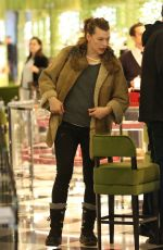 MILLA JOVOVICH and Paul W. S. Anderson Shopping at Prada in Beverly Hills 12/21/2017