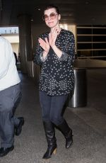 MILLA JOVOVICH at LAX Airport in Los Angeles 12/12/2017
