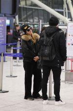 PARIS HILTON and Chris Zylka at Heathrow Airport in London 12/20/2017