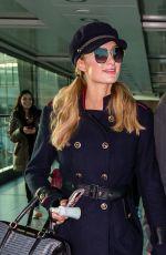 PARIS HILTON at Heathrow Airport in London 12/14/2017