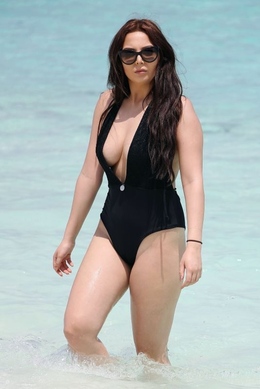 AMELIA GOODMAN in Swimsuit at a Beach in Bahamas 01/02/2018