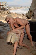 ANGELIQUE FRENCHY MORGAN and SUZIE MALONE in Bikinis at a Beach in Malibu 01/30/2018