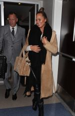 CHRISSY TEIGEN at LAX Airport in Los Angeles 01/18/2018