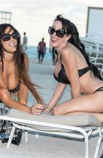 CLAUDIA ROMANI and BELLA BOND in Biknis at a Beach in Miami 01/14/2018
