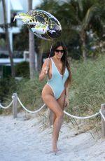 CLAUDIA ROMANI in Swimsuit on the Beach in Miami 12/31/2017