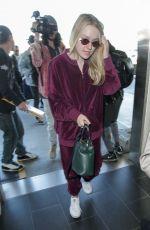 DAKOTA FANNING at LAX Airport in Los Angeles 01/22/2018