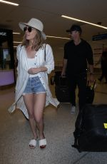 LEANN RIMES in Denim Shorts at LAX Airport in Los Angeles 01/12/2018