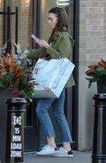 LILY COLLINS Out and About in Cincinnati 01/29/2018