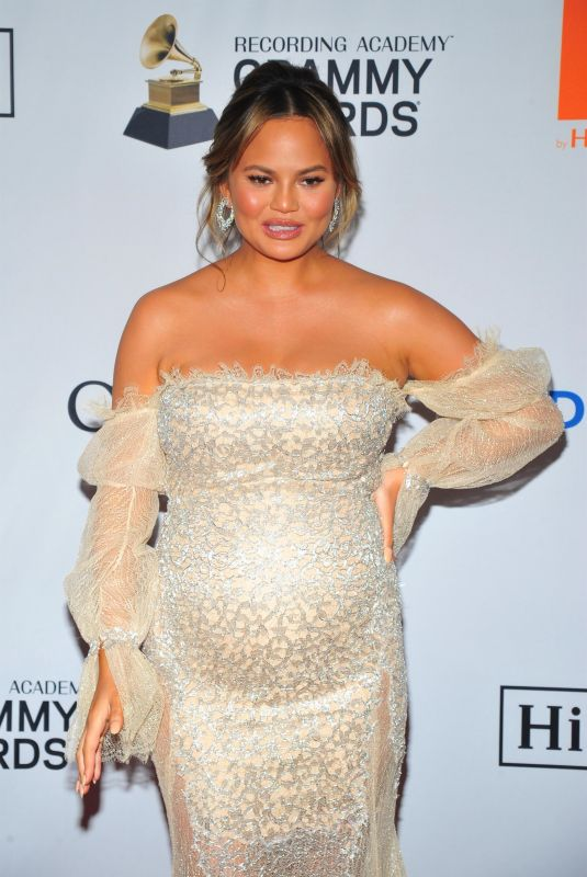 Pregnant CHRISSY TEIGEN at Clive Davis and Recording Academy Pre-Grammy Gala in New York 01/27/2018