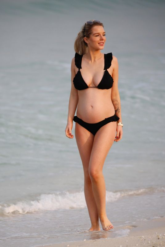 Pregnant HELEN FLANAGAN in Bikini at a Beach in Dubai 01/22/2018