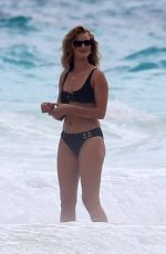 ROSIE HUNTINGTON-WHITELEY in Bikini on the Set of a Photoshoot at a Beach in Bahamas 01/09/2018