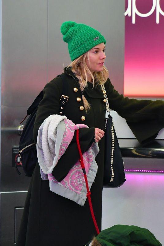 SIENNA MILLER at Heathrow Airport in London 01/06/2018