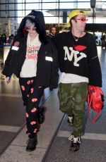 BELLA THORNE and Mod Sun at LAX Airport in Los Angeles 02/25/2018