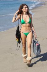 BLANCA BLANCO in a Green Bikini and Ugg Boots Out at Venice Beach 02/07/2018