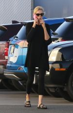 CHARLIZE THERON Out and About in Van Nuys 02/20/2018