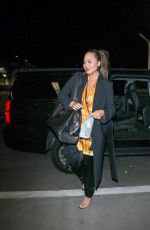 CHRISSY TEIGEN at LAX Airport in Los Angeles 02/24/2018