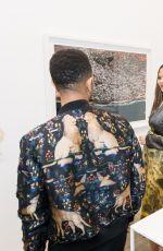 CHRISSY TEIGEN at Nabil Elderkin Exhibition in Los Angeles 02/15/2018